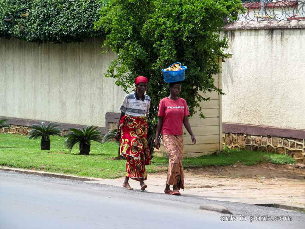 women carrying something on their heads
