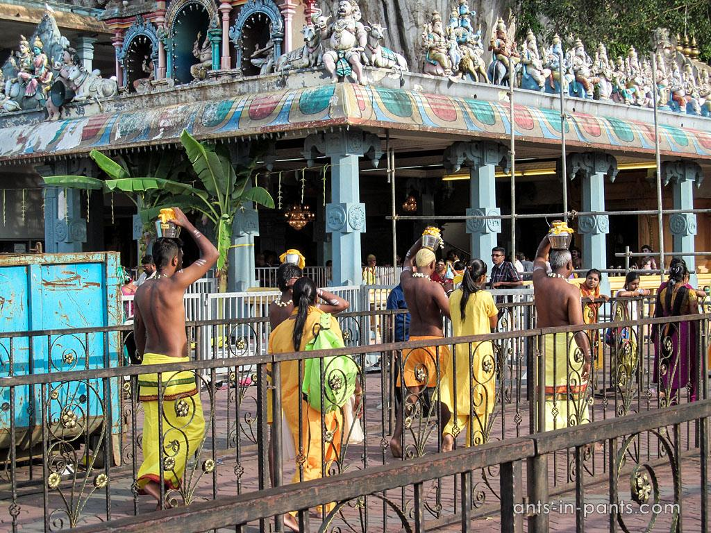 pilgrims bring an offer of milk for Murugan